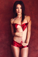 Ashley Doll Strips Out Of Red Bikini