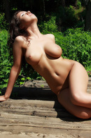 Busty Aurora Poses Nude Outdoors